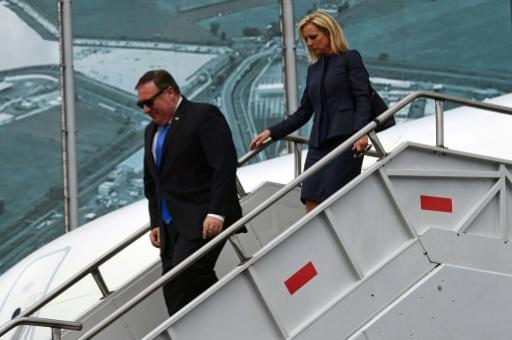 US Secretary of State Mike Pompeo (L) and US Homeland Security Secretary Kirstjen Nielsen disembark from their plane in Mexico City