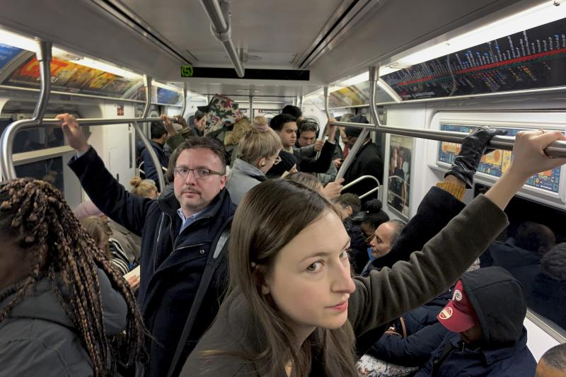 Commuters ride in a subway during the morning rush hour, Thursday, Nov. 15, 2018, in New York. (AP Photo/Wong Maye-E)