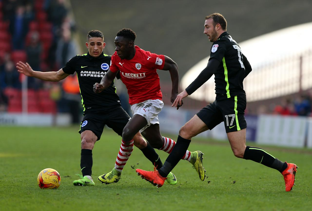 Town are preparing a new bid for the defender, but the Tykes hope the Ghana international will sign a new deal to remain in Oakwell