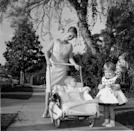 <p>Debbie takes a stroll around her Los Angeles neighborhood with in 1957 with her two young children, Carrie and Todd Fisher. She was still married to her first husband, Eddie Fisher, at the time. </p>