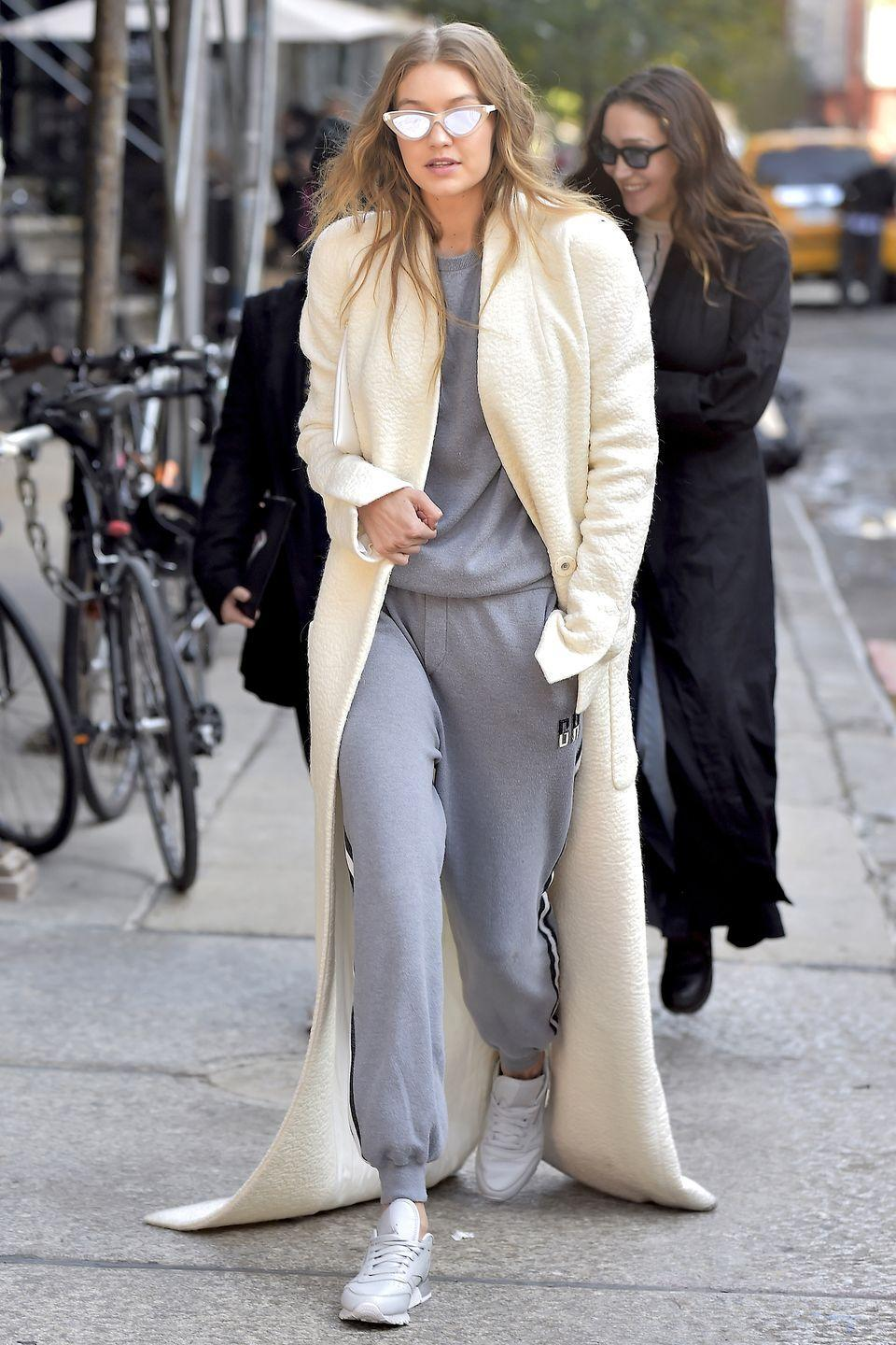 <p>In grey sweats and sneakers, an extra-long textured white coat and reflective cat-eyed Max Mara sunglasses while out in New York. </p>