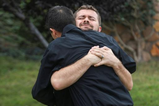 Relatives of the Mormon victims of an attack in Sonora, Mexico embrace during a wake at La Mora Ranch