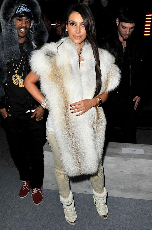 """Also spotted in the City of Light was reality """"star"""" Kim Kardashian, who looked absolutely ridiculous upon arriving at her rumored beau Kanye West's fashion show. We think her fur wrap -- which better be faux -- was the worst part of this look, but perhaps it was her dingy-looking leggings or her $6,800 pearl-adorned Guiseppe Zanotti calf skin heels. Discuss! (3/6/2012)<br><br><a target=""""_blank"""" href=""""http://bit.ly/lifeontheMlist"""">Follow What Were They Thinking?! creator, Matt Whitfield, on Twitter!</a>"""