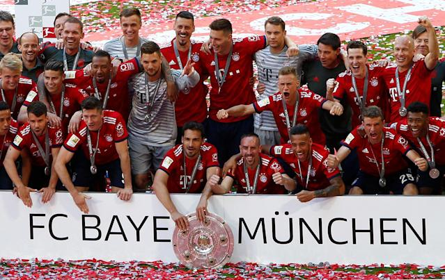 Soccer Football - Bundesliga - Bayern Munich v VfB Stuttgart - Allianz Arena, Munich, Germany - May 12, 2018 Bayern Munich players celebrate winning the Bundesliga with the trophy REUTERS/Michaela Rehle DFL RULES TO LIMIT THE ONLINE USAGE DURING MATCH TIME TO 15 PICTURES PER GAME. IMAGE SEQUENCES TO SIMULATE VIDEO IS NOT ALLOWED AT ANY TIME. FOR FURTHER QUERIES PLEASE CONTACT DFL DIRECTLY AT + 49 69 650050