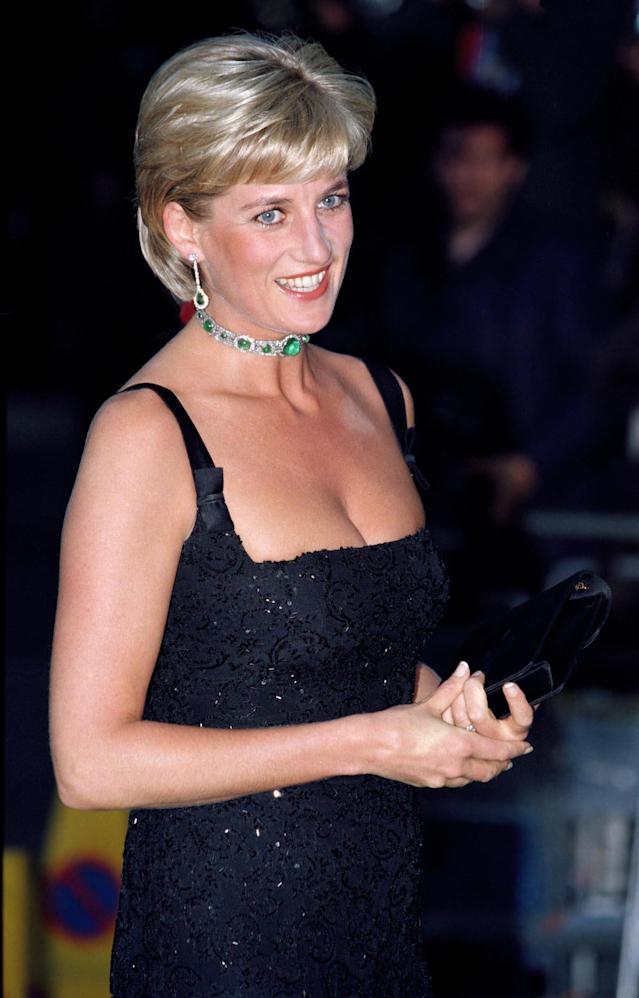 <p>If you lived the '90s, you probably wore a few velvet or leather chokers. Diana spearheaded the trend by putting the crown jewels front and center on her neckline. (Photo: Mark Cuthbert/UK Press via Getty Images) </p>