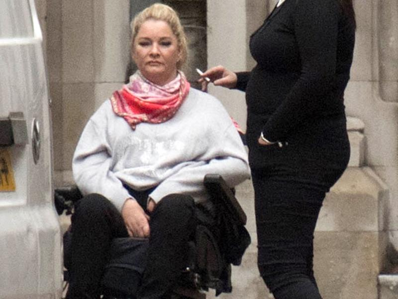 Claire Busby, (left) outside the High Court in London, where she is suing Beds Are Uzzz, for seven-figure damages: PA