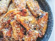 """<h2>38. Everything Chicken Wings</h2> <p>Make a batch and give buffalo sauce a run for its money.</p> <p><a class=""""link rapid-noclick-resp"""" href=""""https://www.purewow.com/recipes/everything-chicken-wings"""" rel=""""nofollow noopener"""" target=""""_blank"""" data-ylk=""""slk:Get the recipe"""">Get the recipe</a></p>"""