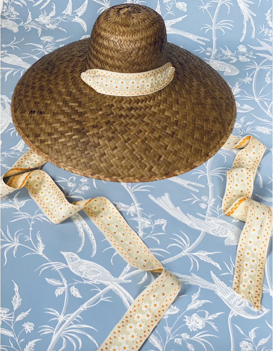 """<p><strong>Sarah Bray Bermuda</strong></p><p>sarahbraybermuda.com</p><p><strong>$150.00</strong></p><p><a href=""""https://sarahbraybermuda.com/products/daisy-sunhat"""" rel=""""nofollow noopener"""" target=""""_blank"""" data-ylk=""""slk:Shop Now"""" class=""""link rapid-noclick-resp"""">Shop Now</a></p><p>Former <em>T&C </em>style writer Sarah Bray's eponymous collection of accessories and tabletop items are made entirely from antique, vintage, recycled, and biodegradable materials. She personally sourced the ribbons for this wide brim sun hat (which is constructed from palm tree leaves) from flea markets, antique dealers, and estate sales.</p>"""