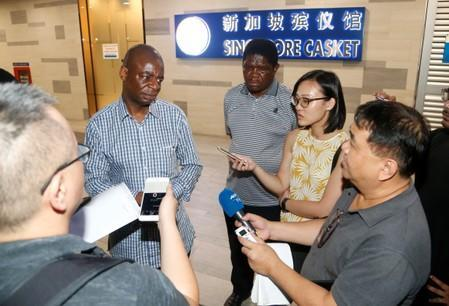 Adam Molai, son-in-law of Albert Mugabe, the late brother of Zimbabwe's former President Robert Mugabe speaks to the media in Singapore