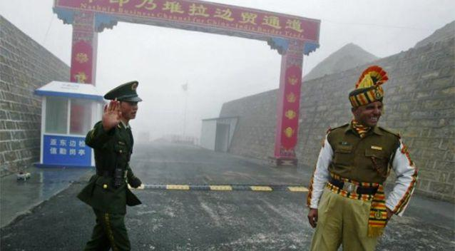PICTURED: A Chinese and Indian soldier at the Nathu La border crossing between India and China in India's Sikkim state. Photo: AFP