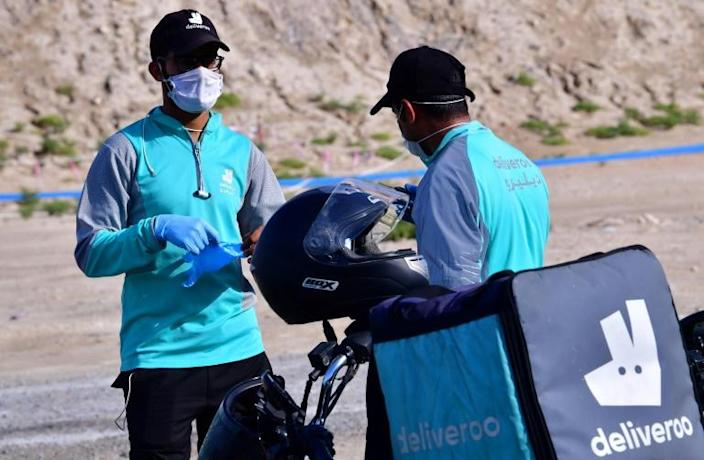 Dubai's army of delivery drivers have made it easier for the glitzy emirate's residents to stay at home and avoid infection (AFP Photo/GIUSEPPE CACACE)