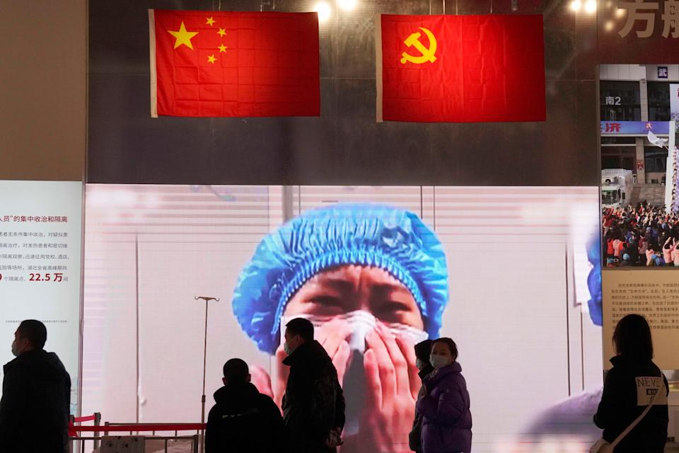 Residents attend an exhibition on the city's fight against the coronavirus in Wuhan (AP)