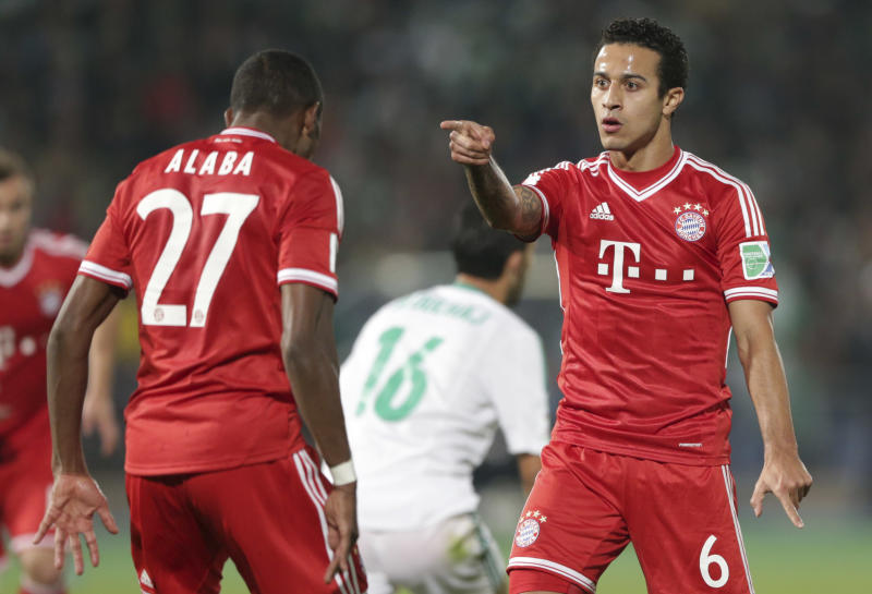 Bayern's Thiago Alcantara, right, celebrates scoring his side's 2nd goal with his teammate David Alaba during the final of the soccer Club World Cup between FC Bayern Munich and Raja Casablanca in Marrakech, Morocco, Saturday, Dec. 21, 2013. (AP Photo/Matthias Schrader)