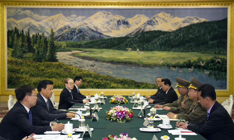 In this May 23, 2013 photo released by China's Xinhua News Agency, Liu Yunshan, second left, a member of the Standing Committee of the Political Bureau of the Communist Party of China (CPC) Central Committee, meets with North Korean envoy Choe Ryong Hae, second right, in Beijing, China. On a visit to repair ties with China and waiting to meet its leader, Choe paid deference Thursday to hopes by the North's chief ally for renewed multinational nuclear talks. (AP Photo/Xinhua, Xie Huanchi) NO SALES