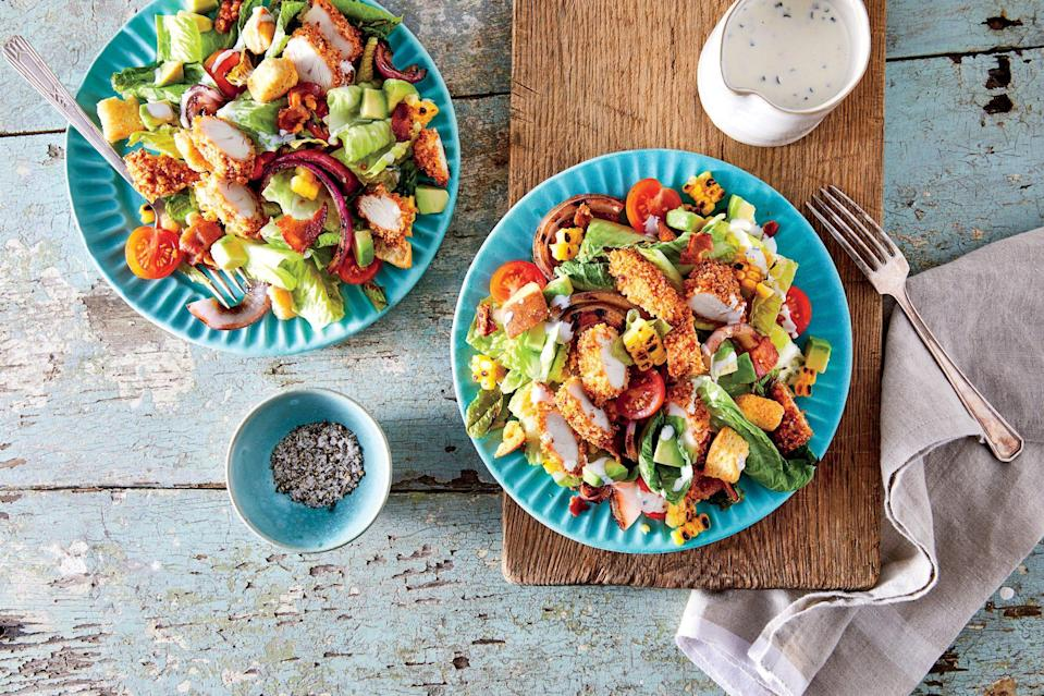 """<p><strong>Recipe: </strong><a href=""""https://www.southernliving.com/recipes/oven-fried-chicken-salad-buttermilk-ranch-dressing-recipe"""" rel=""""nofollow noopener"""" target=""""_blank"""" data-ylk=""""slk:Oven-Fried Chicken Salad with Buttermilk Ranch Dressing"""" class=""""link rapid-noclick-resp""""><strong>Oven-Fried Chicken Salad with Buttermilk Ranch Dressing</strong></a></p> <p>Get classic fried chicken flavor without the mess and grease with these oven-baked tenders.</p>"""