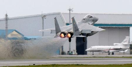 Japanese Air Self Defense Force F-15 fighter scrambles at the Air Self Defense Force Naha base in Naha