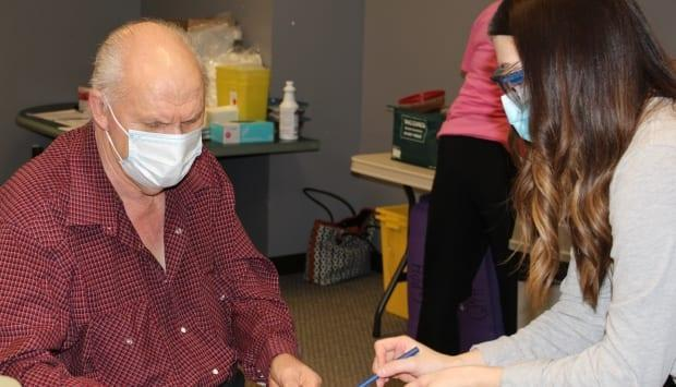 'I'm excited to finally get my vaccine,' Richard Wright, 75, told AHS staff. He received his first dose of the vaccine Wednesday in Grande Prairie. 'I'm hoping to be able to safely visit friends and family this summer.'