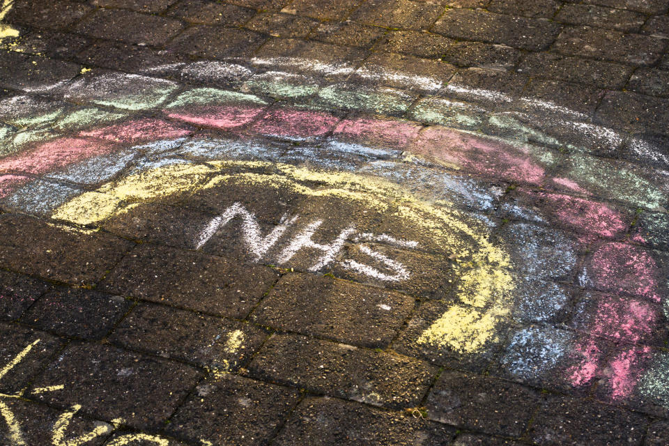 An NHS rainbow drawn on the ground in chalk