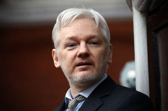 WikiLeaks founder Julian Assange speaks from the balcony of the Ecuadorian Embassy, where he continues to seek asylum, in London, England. (Photo: Carl Court/Getty Images)