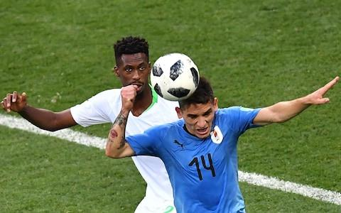 Uruguay's midfielder Lucas Torreira (R) fights for the ball with Saudi Arabia's midfielder Mohamed Kanno during the Russia 2018 World Cup Group A football match between Uruguay and Saudi Arabia at the Rostov Arena in Rostov-On-Don on June 20, 2018. Uruguay won 1-0. - Credit: AFP