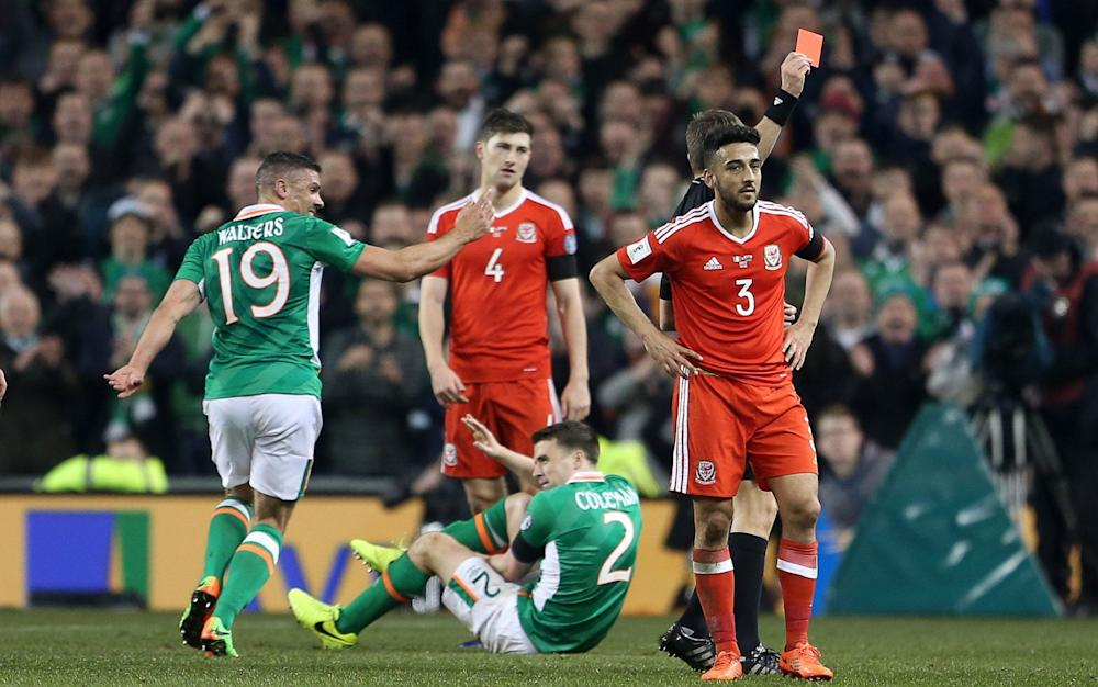 Neil Taylor of Wales is given a red card by referee Nicola Rizzoli for his tackle on Seamus Coleman