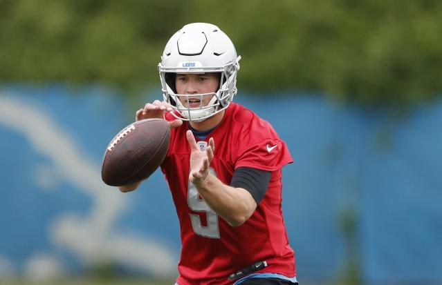 Detroit Lions quarterback Matthew Stafford takes a snap during drills at the team's NFL football practice facility, Tuesday, May 21, 2019, in Allen Park, Mich. (AP Photo/Carlos Osorio)