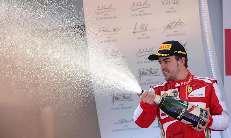 Ferrari driver Fernando Alonso of Spain sprays Champagne after winning the Formula One Spanish Grand Prix at the Catalunya racetrack in Montmelo, near Barcelona, Spain, Sunday, May 12, 2013. (AP Photo/Manu Fernandez)