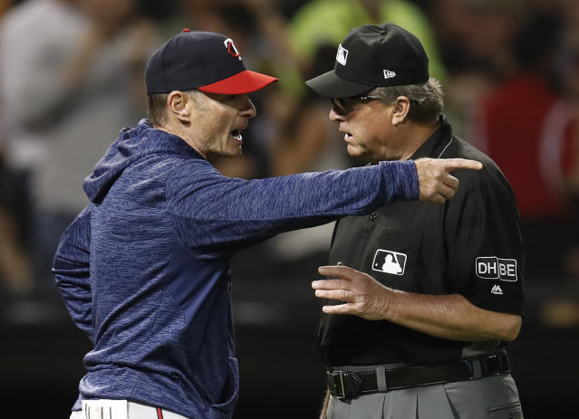 FILE - In this June 27, 2018, file photo, Minnesota Twins' manager Paul Molitor, left, argues with third base umpire Gerry Davis during the sixth inning of the team's baseball game against the Chicago White Sox, in Chicago. The Minnesota Twins fired Paul Molitor on Tuesday, Oct. 2, 2018, one season after he won the American League Manager of the Year award. Molitor has been offered another position within the organization. (AP Photo/Jim Young, File)