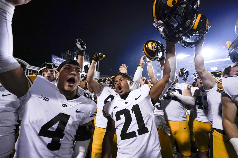 Iowa players celebrate after defeating Maryland 51-14 during an NCAA college football game, Friday, Oct. 1, 2021, in College Park, Md. (AP Photo/Julio Cortez)