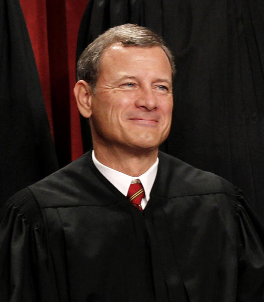 "FILE - In this Oct. 8, 2010 file photo, Chief Justice John Roberts is seen during the group portrait at the Supreme Court Building in Washington. Breaking with the court's other conservative justices, Roberts announced the judgment that allows the law to go forward with its aim of covering more than 30 million uninsured Americans. Roberts explained at length the court's view of the mandate as a valid exercise of Congress' authority to ""lay and collect taxes."" The administration estimates that roughly 4 million people will pay the penalty rather than buy insurance. (AP Photo/Pablo Martinez Monsivais, File)"