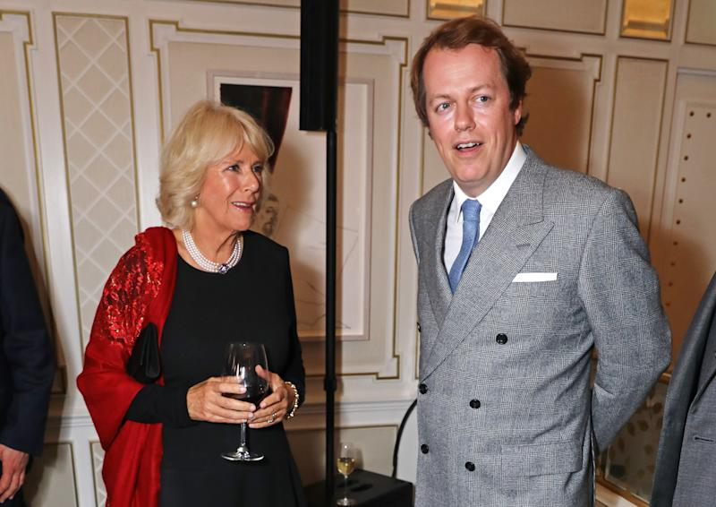 """LONDON, ENGLAND - OCTOBER 18: Camilla, Duchess of Cornwall, and son Tom Parker Bowles attend the launch of """"Fortnum & Mason: The Cook Book"""" by Tom Parker Bowles at Fortnum & Mason on October 18, 2016 in London, England. (Photo by David M. Benett/Dave Benett/Getty Images for Fortnum and Mason)"""
