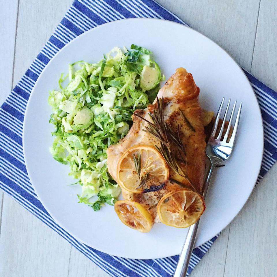 """<p>If you're thinking about cheating and calling up takeout-don't. This chicken dinner is stupid simple to make.</p><p>Get the recipe from <a rel=""""nofollow"""" href=""""http://www.delish.com/cooking/recipe-ideas/recipes/a44910/lemon-garlic-rosemary-roasted-chicken-breasts-brussels-sprouts-slaw/"""">Delish</a>.</p>"""