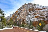 <p>Zion National Park is known for its steep red cliffs. It may not get as snowy here as it does in other national parks, but the snow still falls - and the red rock looks even more gorgeous when dusted with some fresh powder. </p>
