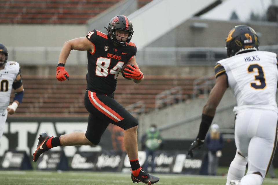Oregon State tight end Teagan Quitoriano (84) squares off with California safety Elijah Hicks (3) during the second half of an NCAA college football game in Corvallis, Ore., Saturday, Nov. 21, 2020. Oregon State won 31-27. (AP Photo/Amanda Loman)
