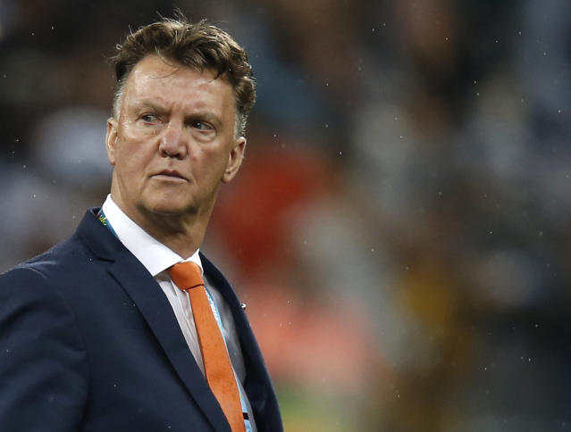 Louis van Gaal reacts after the World Cup semi-final between Netherlands and Argentina at The Corinthians Arena in Sao Paulo, on July 9, 2014 (AFP Photo/Adrian Dennis)