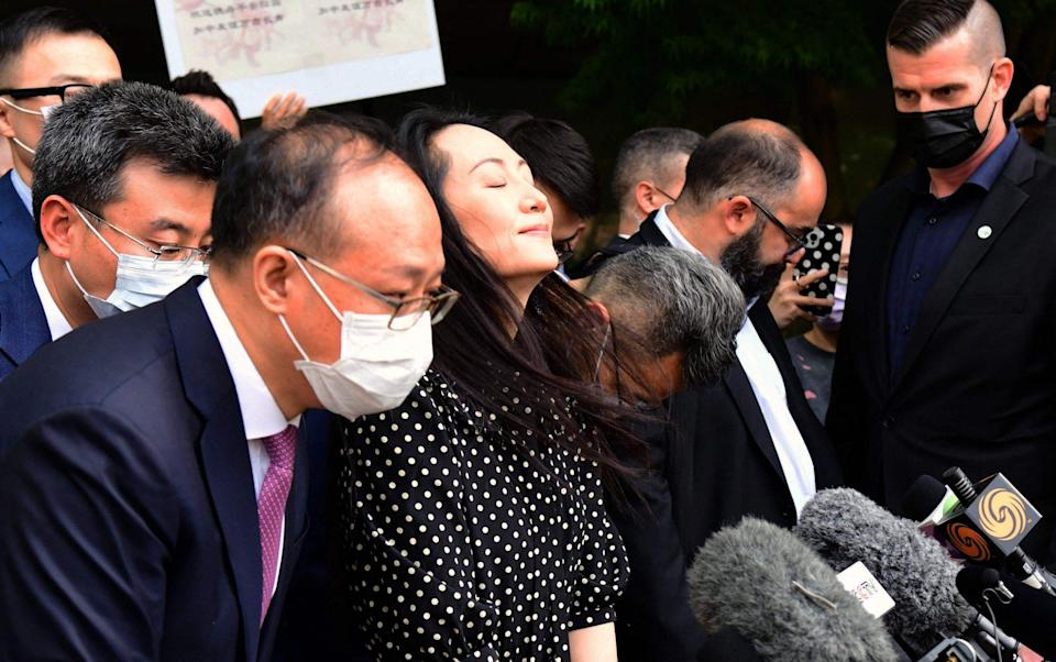 Huawei chief financial officer Meng Wanzhou talks to the media at British Columbia Supreme Court after her extradition hearing ended in her favour, in Vancouver British Columbia, Canada on Friday - DON MACKINNON/AFP