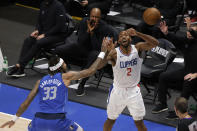 Dallas Mavericks center Willie Cauley-Stein (33) fouls Los Angeles Clippers forward Kawhi Leonard (2) on a three point-attempt in the second half during Game 6 of an NBA basketball first-round playoff series in Dallas, Friday, June 4, 2021. (AP Photo/Michael Ainsworth)