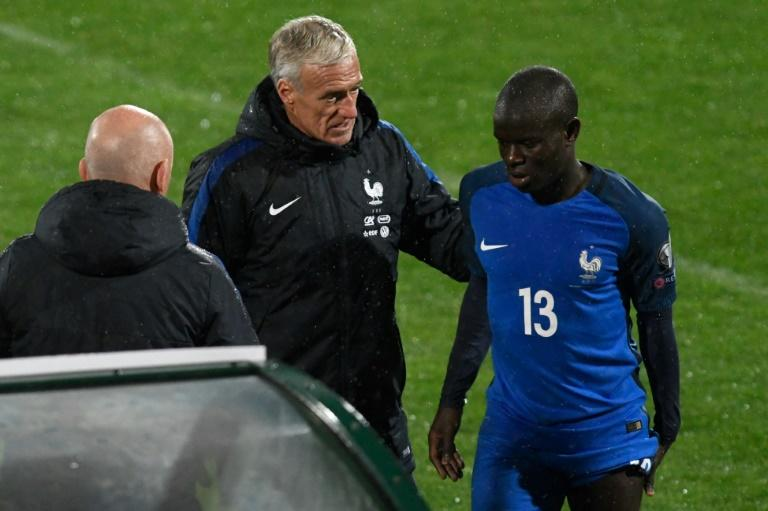 France coach Didier Deschamps (C) consoles defender N'golo Kante after he was substituted with an injury during the World Cup 2018 qualifying match against Bulgaria at The Vasil Levski Stadium in Sofia on October 7, 20177