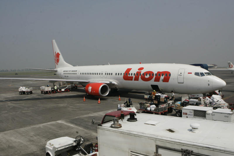 In this May 12, 2012 photo, a Lion Air passenger jet is parked on the tarmac at Juanda International Airport in Surabaya, Indonesia. Dozens of fledgling airlines that have sprung up to serve Indonesia's island-hopping new middle class could jeopardize the archipelago's recently improved safety reputation, aviation experts say. (AP Photo/Trisnadi)