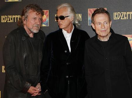 "Led Zeppelin singer Plant, guitarist Page and bassist/keyboardist Paul Jones pose for photographers as they arrive for the U.K. premiere of ""Celebration Day"" at the Hammersmith Apollo in London"