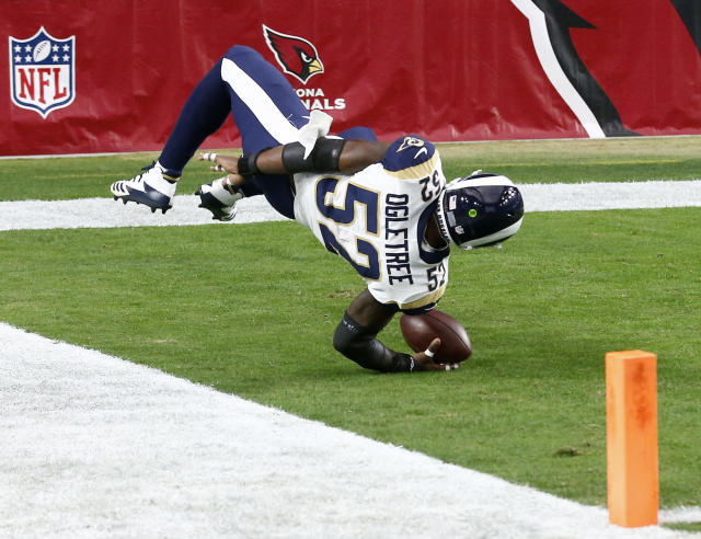<p>Los Angeles Rams inside linebacker Alec Ogletree (52) falls into the end zone after an interception for a touchdown against the Arizona Cardinals during the first half of an NFL football game, Sunday, Dec. 3, 2017, in Glendale, Ariz. (AP Photo/Ross D. Franklin) </p>