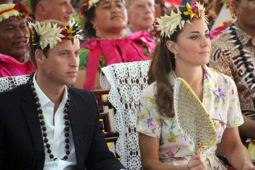 <p>Prince William (L) and his wife Catherine attend a farewell ceremony in Tuvalu on September 19, 2012. A Swedish celebrity magazine published pictures of Catherine sunbathing topless, a day before a Danish publication was to do the same despite fury from the royals.</p>