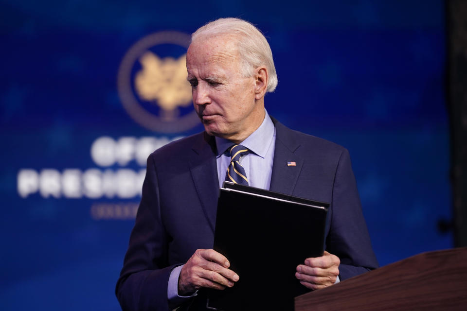 President-elect Joe Biden leaves after speaking at The Queen theater, Monday, Dec. 28, 2020, in Wilmington, Del. (AP Photo/Andrew Harnik)