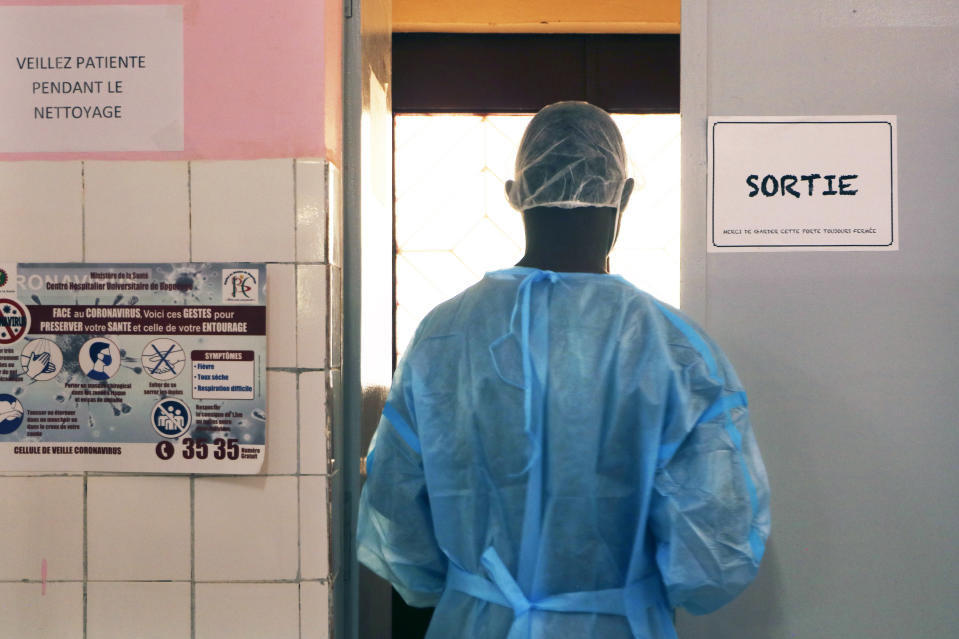 Dr. Dieudonne Wend-Kuni Kientega tends to COVID-19 patients at Ouagadougou's Bogodogo Medical Teaching Hospital Thursday Feb. 4, 2021. Since November, the conflict-riddled West African nation of Burkina Faso faces a much deadlier second coronavirus wave than the first and health officials worry a lack of knowledge and adherence to coronavirus measures is making it hard to rein in. (AP Photo/Sam Mednick)