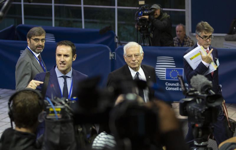 Incoming European Union foreign policy chief Josep Borrell, center, speaks with the media as he arrives for a meeting of EU foreign ministers at the European Convention Center in Luxembourg, Monday, Oct. 14, 2019. Some European Union nations are looking to extend moves against Turkey by getting more nations to ban arms exports to Ankara to protest the offensive in neighboring Syria. (AP Photo/Virginia Mayo)