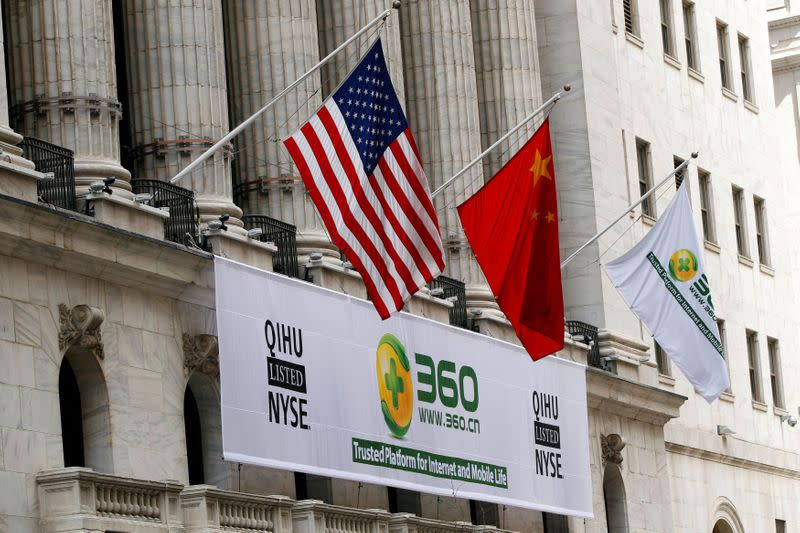 FILE PHOTO: A sign advertising the Qihoo 360 Technology Co Ltd is hung with the U.S. and Chinese flags outside of the New York Stock Exchange