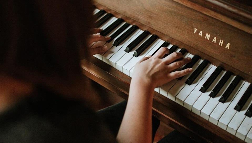 A person playing the piano. Photo: Jordan Whitfield