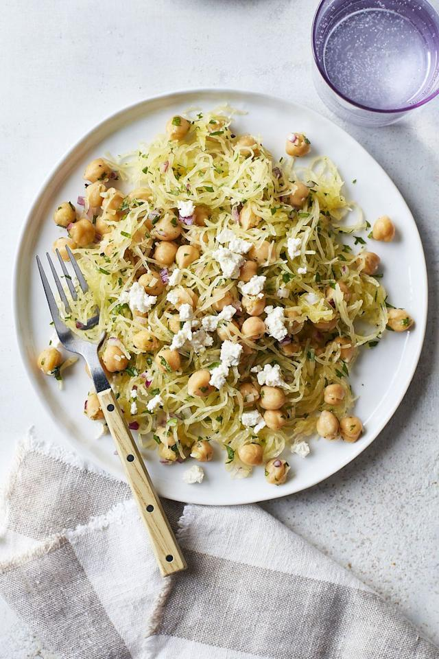 """<p>Give your spaghetti squash a boost by adding chickpeas, lemon juice, and crumbled feta cheese. </p><p><strong><a rel=""""nofollow"""" href=""""https://www.womansday.com/food-recipes/food-drinks/a16764648/spaghetti-squash-and-chickpea-saute-recipe/"""">Get the recipe.</a> </strong></p>"""