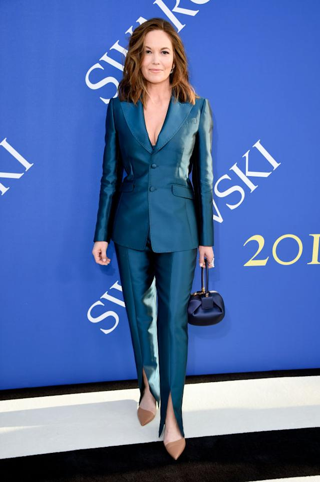 <p>Diane Lane attends the 2018 CFDA Fashion Awards at the Brooklyn Museum wearing a Gabriela Hearst silk wool suit, nude heels, and the Demi bag in navy on June 4, 2018, in New York City. (Photo: Getty Images) </p>