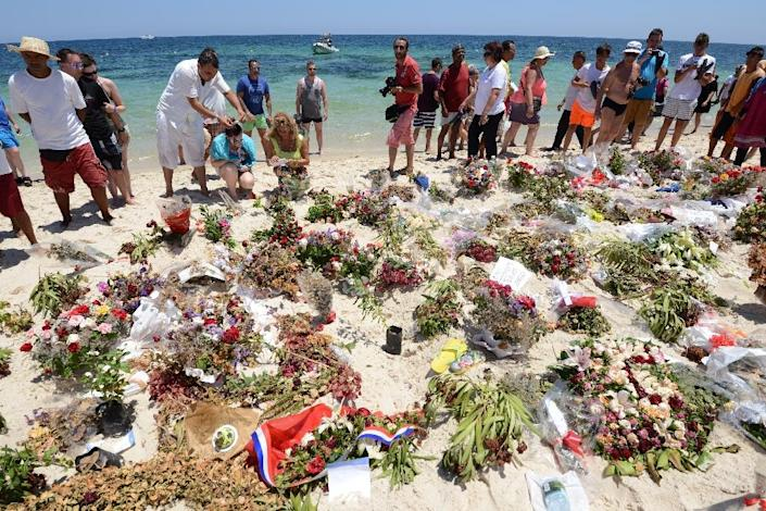 Tourists and Tunisians pay tribute to those killed by a jihadist gunman on a beach in the resort of Sousse in July (AFP Photo/Fethi Belaid)